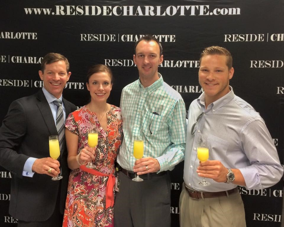 Matthew Paul Brown | Reside Charlotte pictured with Adam and Cara at their closing of their Charlotte home!